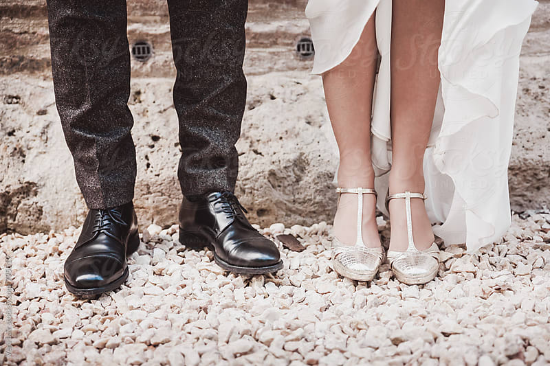 Bride and Groom legs  by Vera Lair for Stocksy United