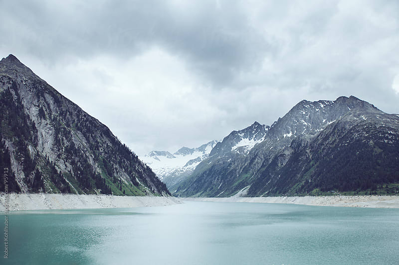Lake scenic with mountains by Robert Kohlhuber for Stocksy United