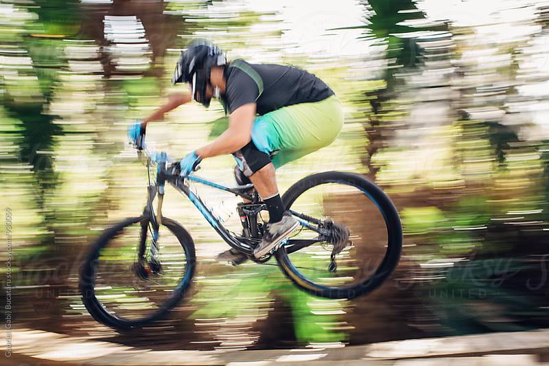 Mountain bike rider jumping by Gabriel (Gabi) Bucataru for Stocksy United