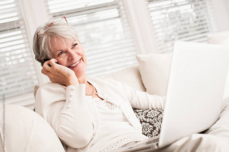 Happy Multi-tasking Mature Woman by Cameron Whitman for Stocksy United