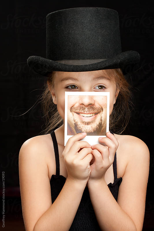 Movember Supporter - Girl with Polaroid of Mustache by Geoffrey Hammond for Stocksy United