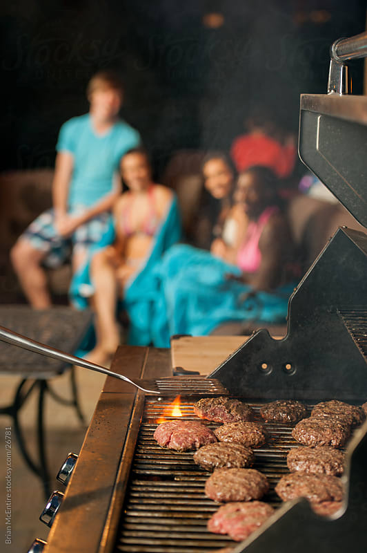 Hamburgers on Grill at Family Summer Party by Brian McEntire for Stocksy United
