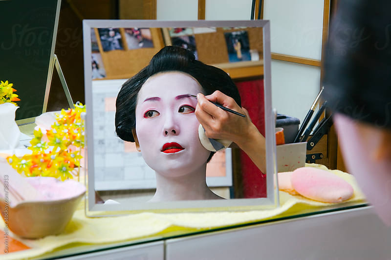 Asia, Japan, Honshu, Kansai Region, Kyoto, Geisha having make-up applied by Gavin Hellier for Stocksy United