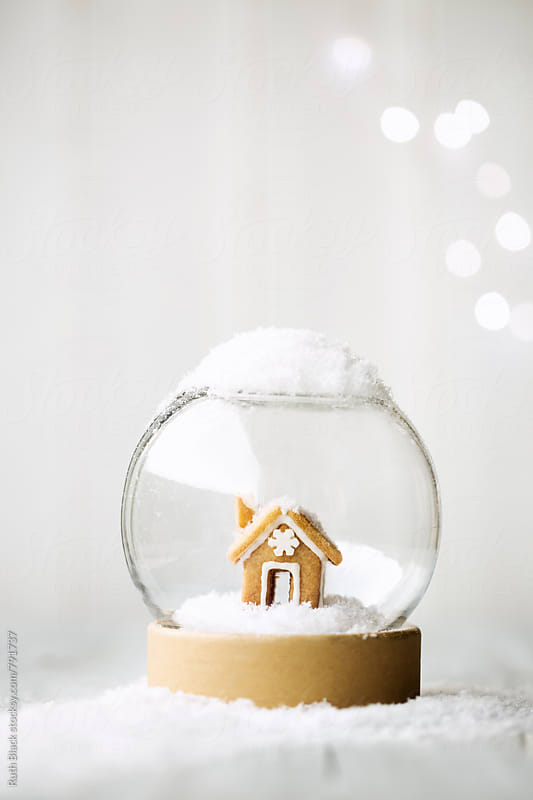 Gingerbread house snow globe by Ruth Black for Stocksy United