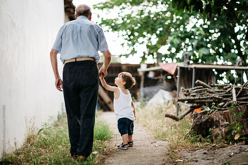 Grandfather with his grandson  by Nasos Zovoilis for Stocksy United