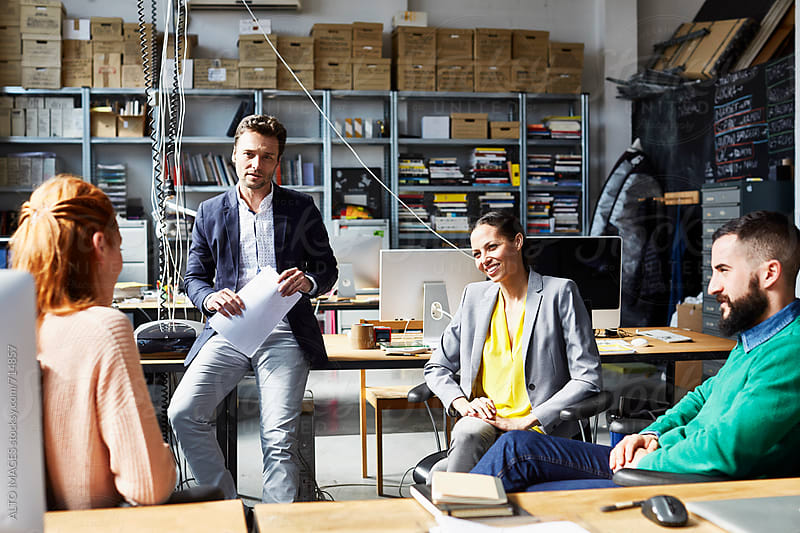 Business People Discussing Plan In Startup Office by ALTO IMAGES for Stocksy United