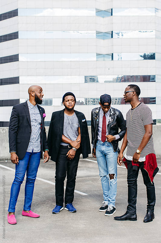 Group of young gentleman in the city  by Kristen Curette Hines for Stocksy United