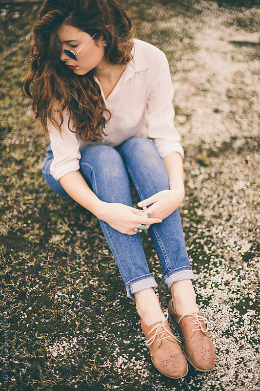 Beautiful fashionable young woman in blue jeans and oxford shoes. by Nabi Tang for Stocksy United