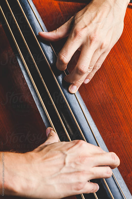 Masculine Hands Playing a Double Bass by Giorgio Magini for Stocksy United