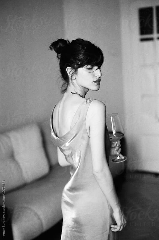 Stylish woman with glass of wine by Lyuba Burakova for Stocksy United