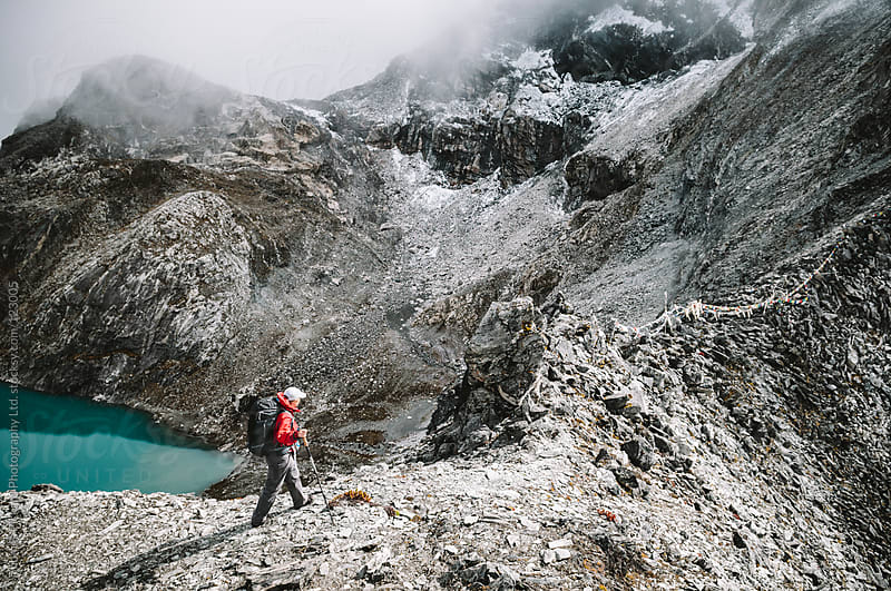Female trekker approaching Kongma La Pass, Everest Region, Sagarmatha National Park, Nepal. by Thomas Pickard Photography Ltd. for Stocksy United