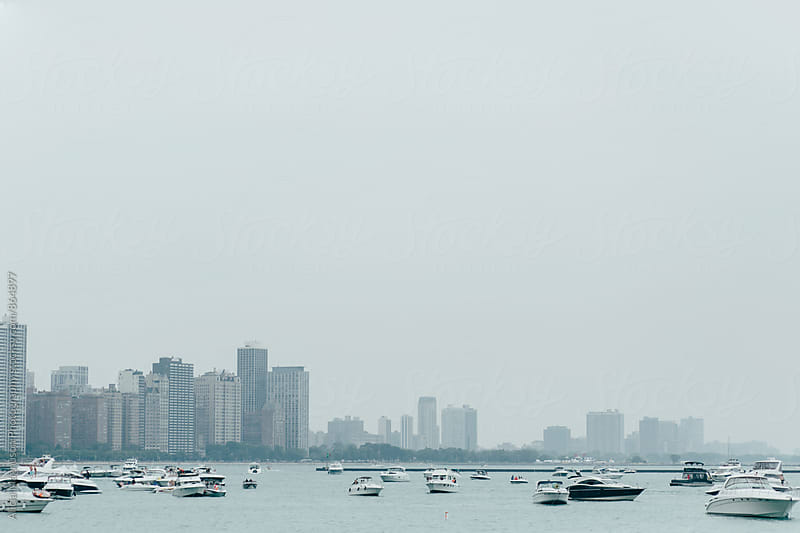Boats and the Chicago Skyline on Overcast Summer Day by Alicia Magnuson Photography for Stocksy United