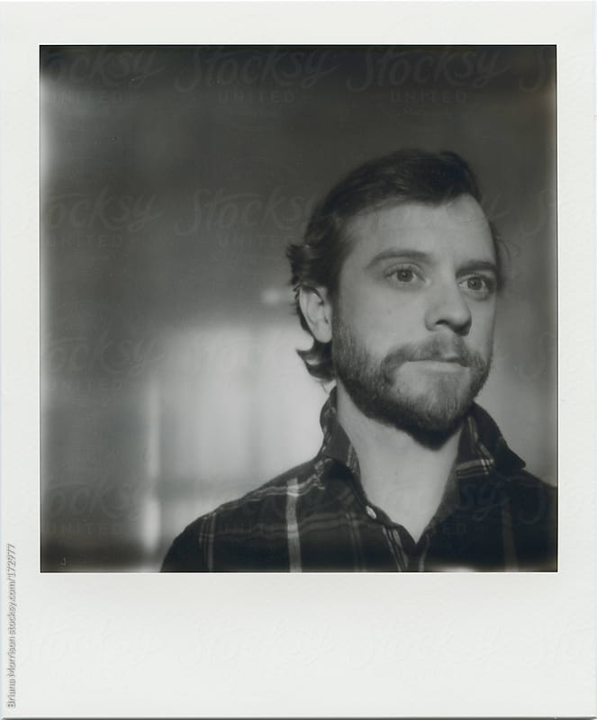 Polaroid of Man with Beard and Plaid Shirt by Briana Morrison for Stocksy United