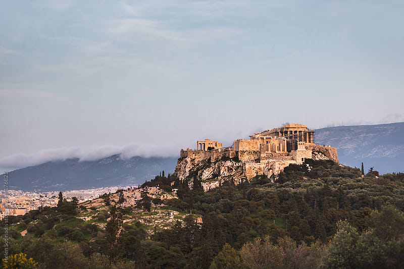 The Acropolis Lit by the Setting Sun by Helen Sotiriadis for Stocksy United
