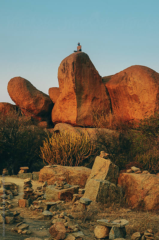 Man Sitting On TopOf A Huge Stone  by Alexander Grabchilev for Stocksy United