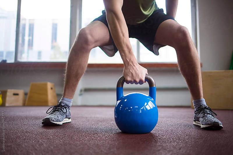 Man Lifting a Kettle Bell