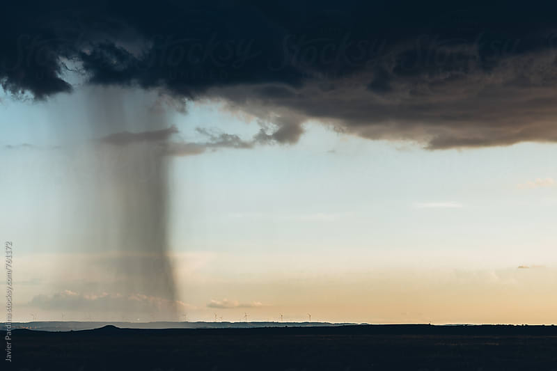 storm clouds at sky sunset. by Javier Pardina for Stocksy United