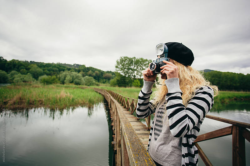 Girl taking photos with a vintage camera by michela ravasio for Stocksy United