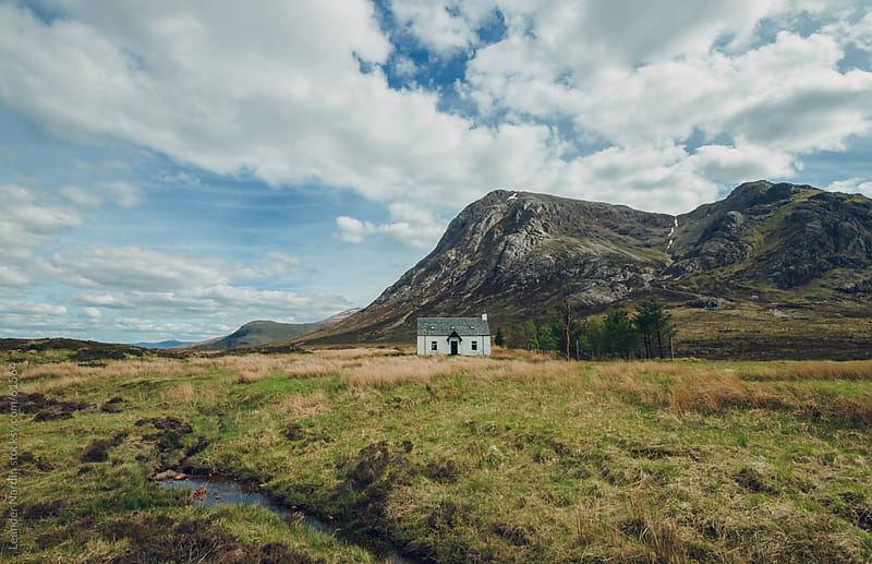 lonesome house in the scottish highlands by Leander Nardin for Stocksy United