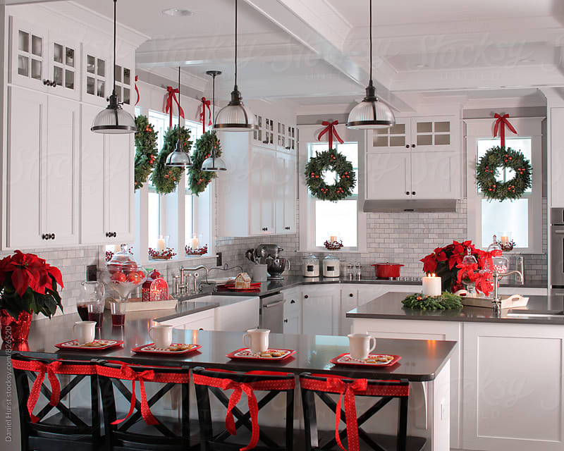 Kitchen with festive Christmas decorations by Daniel Hurst for Stocksy United