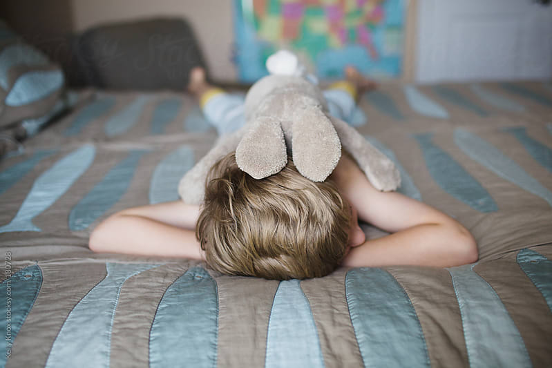 a boy and his bunny by Kelly Knox for Stocksy United