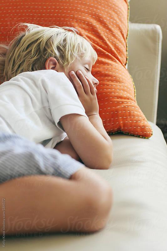 a sweet, little boy sleeping by Kelly Knox for Stocksy United
