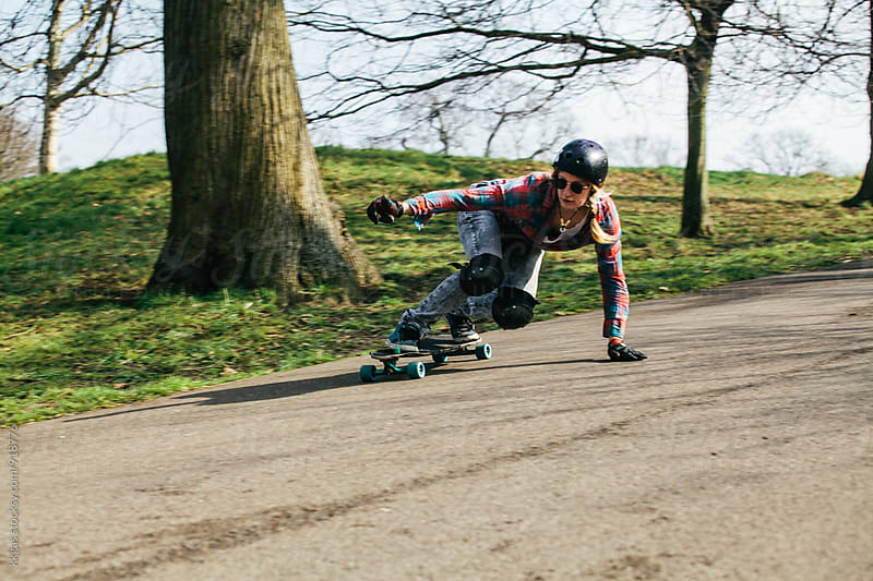 Woman practicing downhill longboarding by kkgas for Stocksy United