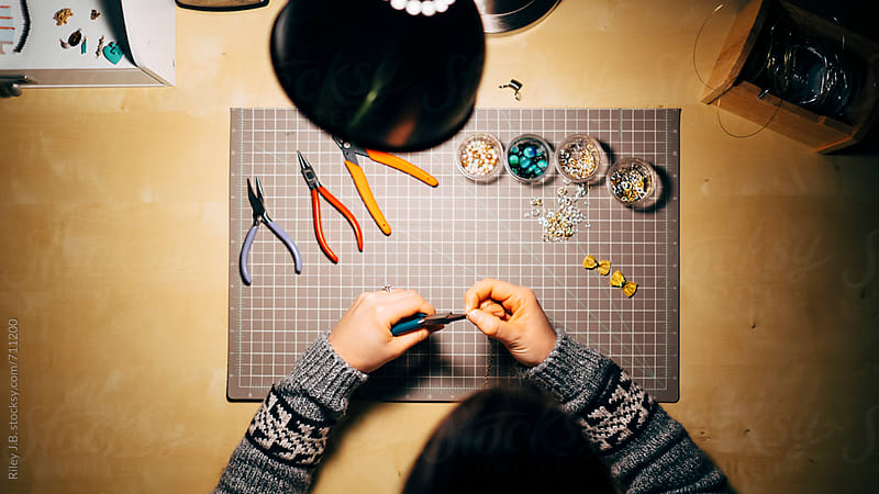 Woman using jewelry tools from above by Riley Joseph for Stocksy United