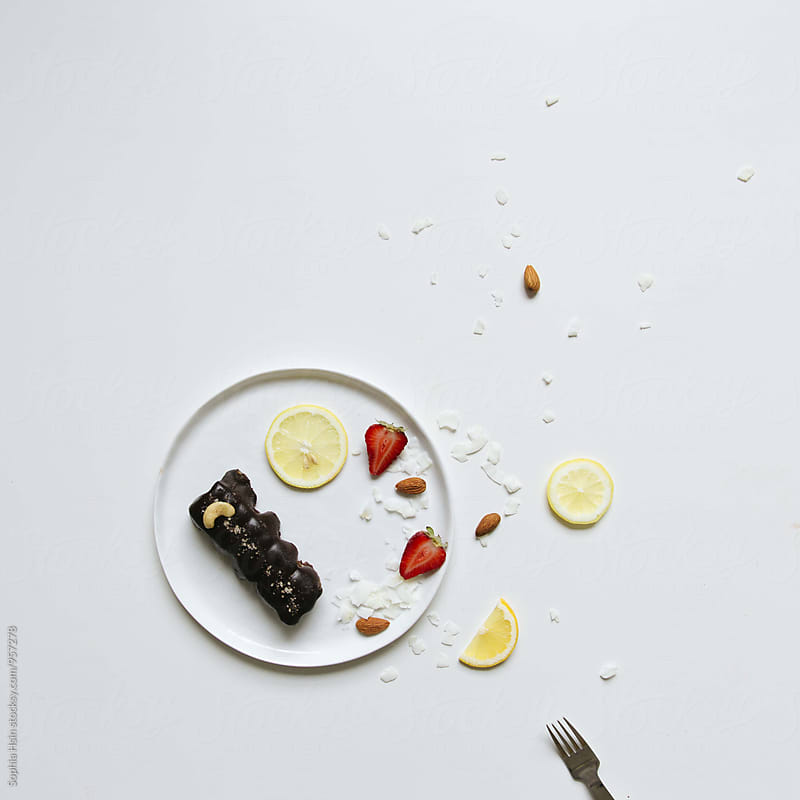 Chocolate cake on white plate by Sophia Hsin for Stocksy United