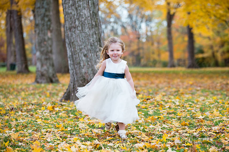 flower girl running through the park by Brian Powell for Stocksy United