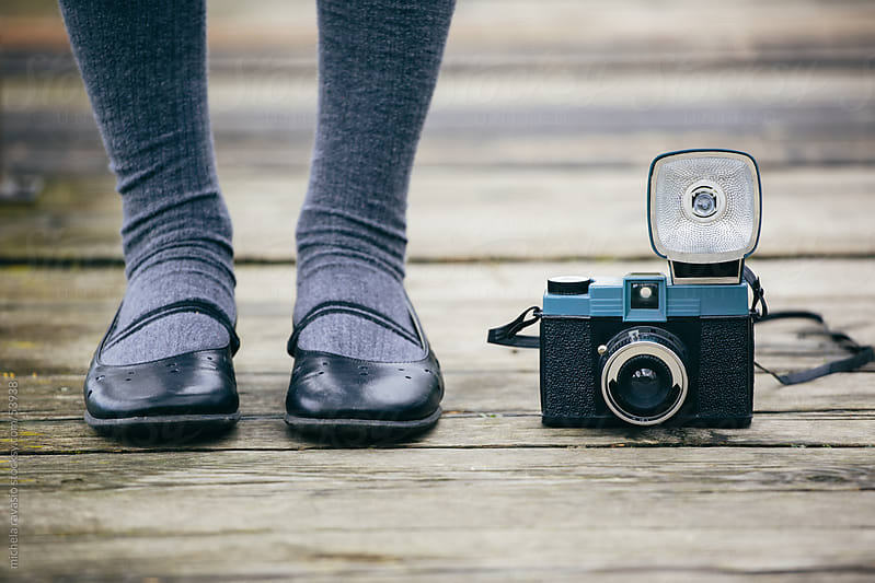 Vintage camera and shoes by michela ravasio for Stocksy United