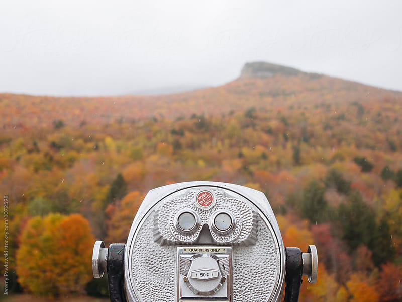 Binoculars for tourists in colorful autumn foliage scene. New Hampshire. by Jeremy Pawlowski for Stocksy United