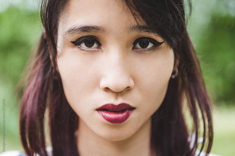Serious Asian Teenage Girl Headshot by Giorgio Magini for Stocksy United