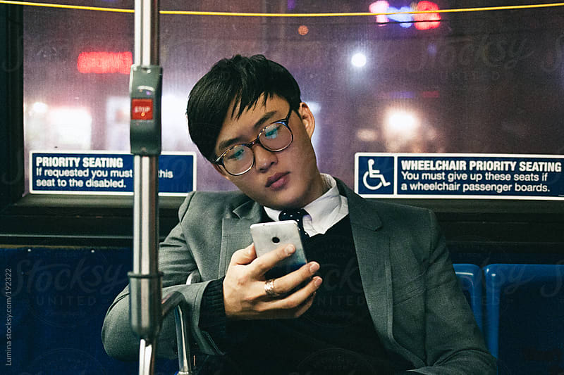 Man Texting on the Subway by Lumina for Stocksy United