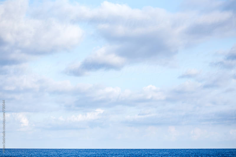 White Soft Clouds over the Horizon at Sea by Helen Sotiriadis for Stocksy United