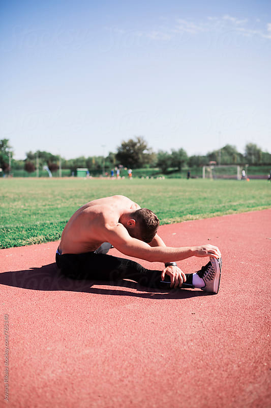 Man warming up before workout by Jovana Rikalo for Stocksy United