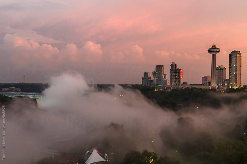 Fog over Niagara Falls at Sunset. View from the Canadian Side. by Tom Uhlenberg for Stocksy United