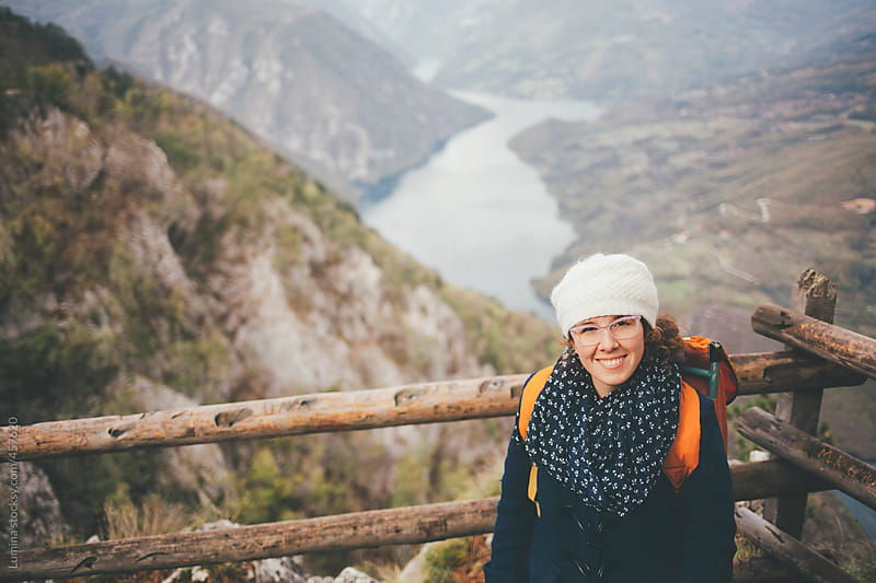 Smiling Hiker at a Beautiful Mountain Viewpoint by Lumina for Stocksy United