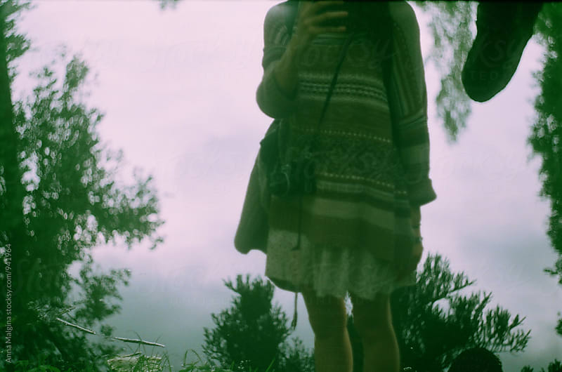 A film photo of a young woman nearby lake by Anna Malgina for Stocksy United