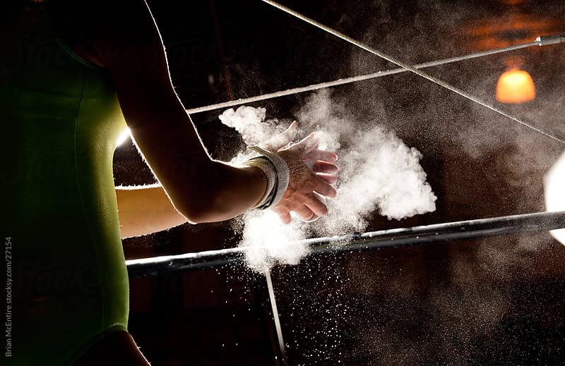 Chalk Talcum Powder Flies As Female Gymnast Preparess for Bars by Brian McEntire for Stocksy United