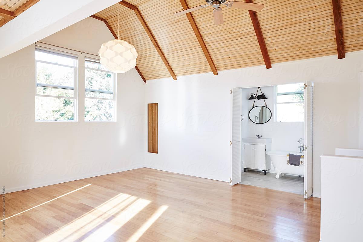 Empty Bedroom With Wood Floors Inside Cottage Stocksy United