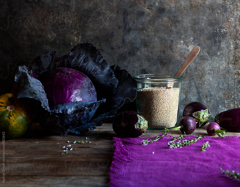 Food still life of quinoa, aubergines, radish, red cabbage, squash and herbs by Nadine Greeff for Stocksy United