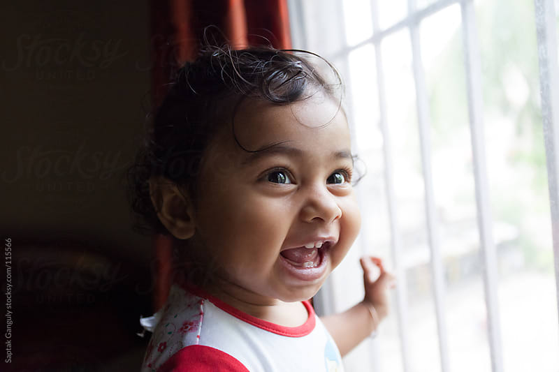 Cute baby girl laughing  by Saptak Ganguly for Stocksy United