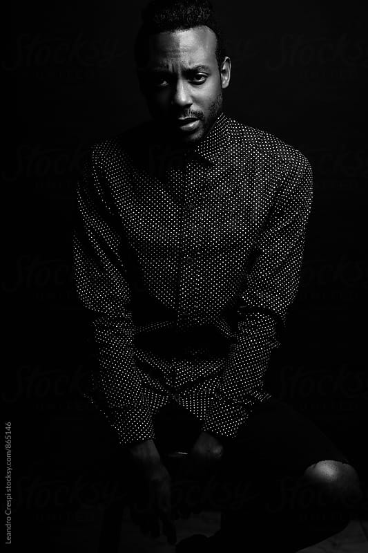 Single black man by Leandro Crespi for Stocksy United