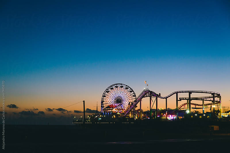 View of Santa Monica pier at dusk. Evening theme park by Alejandro Moreno de Carlos for Stocksy United