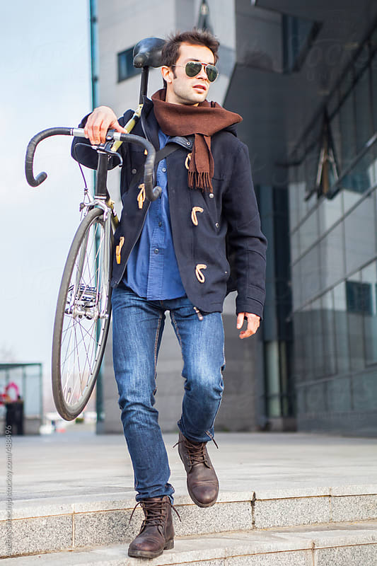 Portrait of modern male with bike. by Audrey Shtecinjo for Stocksy United