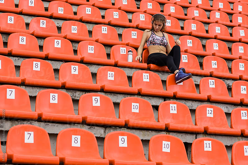 Woman at stadium by Milles Studio for Stocksy United