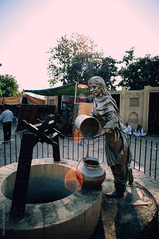A sculpture of a villager by Murtaza Daud for Stocksy United