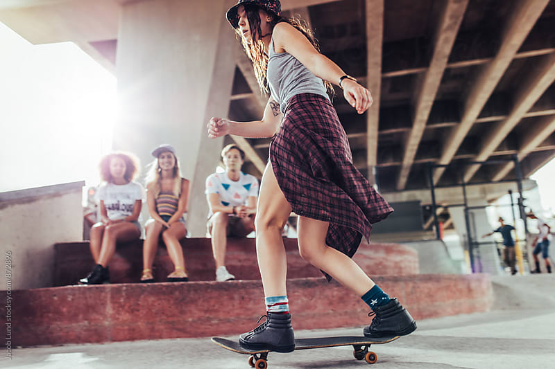 Young woman skateboarding at skate park by Jacob Lund for Stocksy United