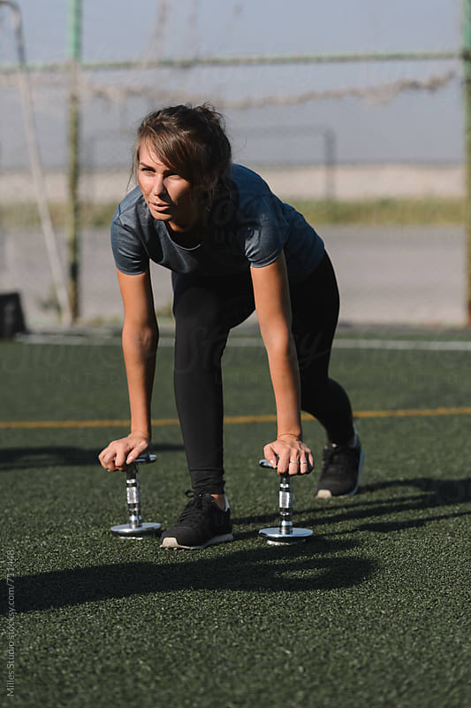 Woman doing lunge exercise  by Milles Studio for Stocksy United
